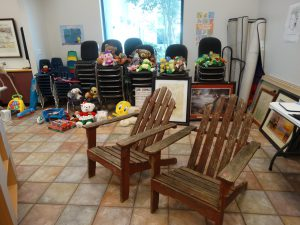 chairs and stuffed animals, garage sale