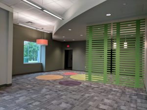 green divider divides teen area from main part of library, looking at the new Ringer teen area, photo taken May 8, 2019